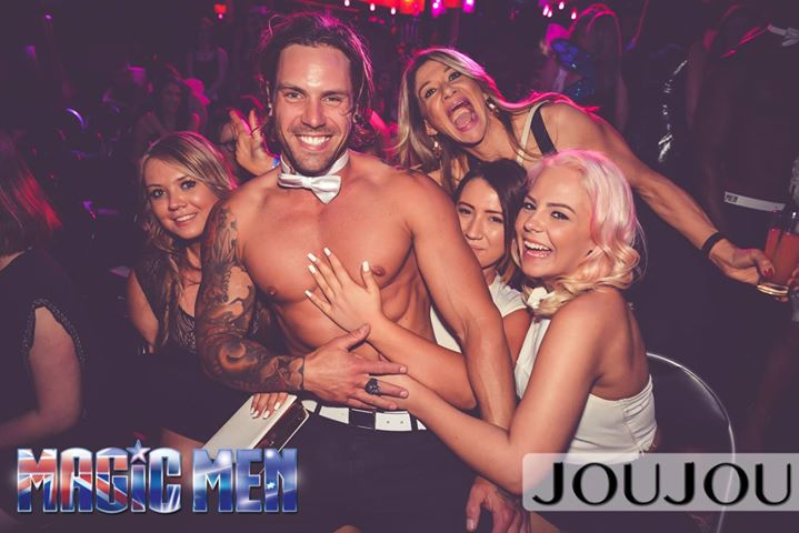 some ladies enjoying topless waiter nick