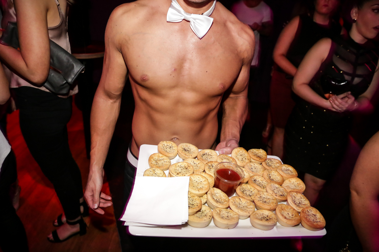 topless waiter serving food