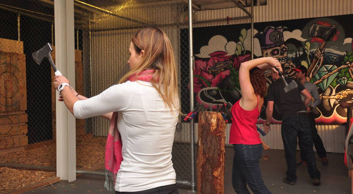girls throwing axe