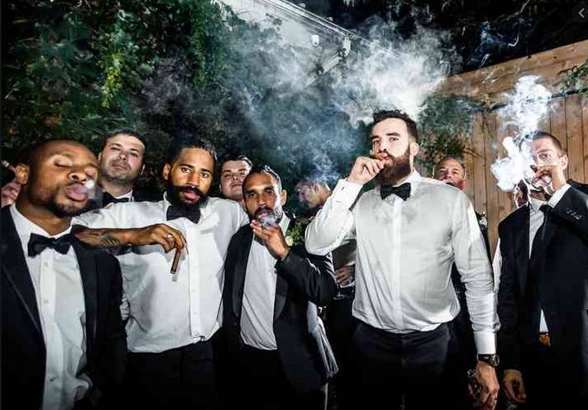 guys drinking and smoking cigars